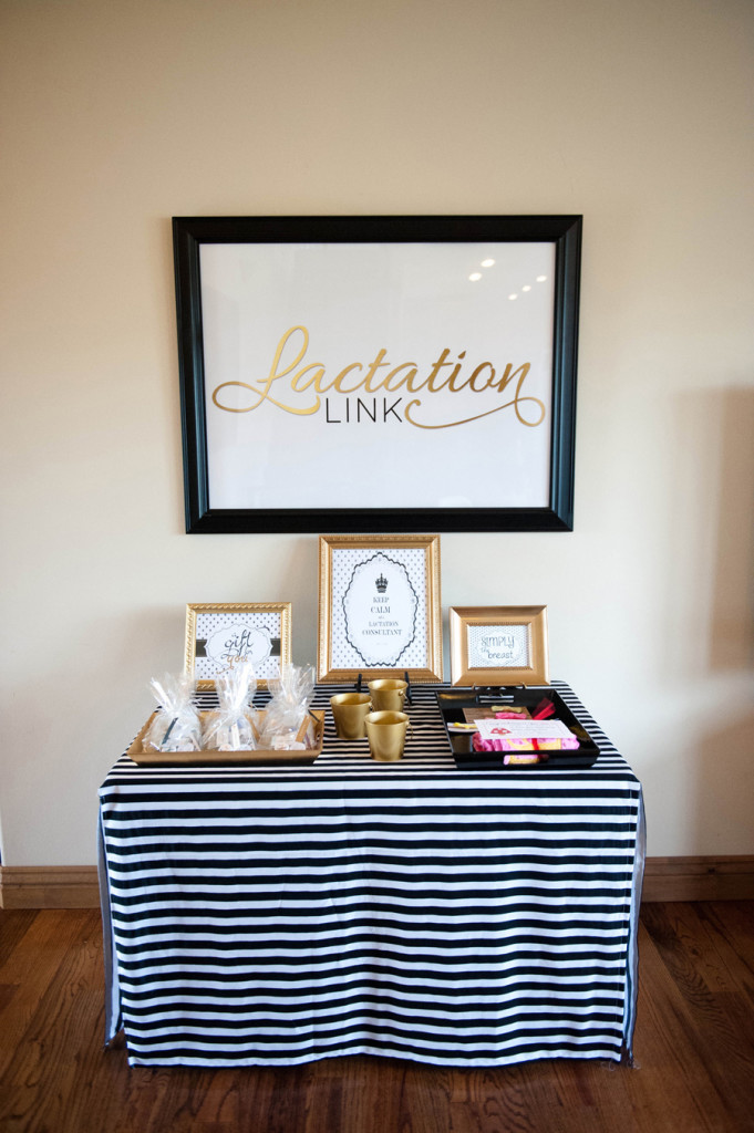 picture frame with lactation link logo above a gift bag table