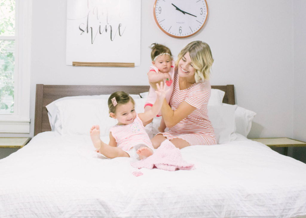 Mom and two children sitting in bed